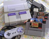 SNES Console with The Legend of Zelda: A Link to the Past and Two Other Games