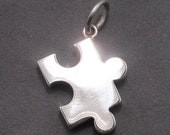 Sterling silver puzzle piece charm/pendant