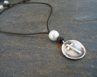 Sterling silver stamped cross on pearl and leather