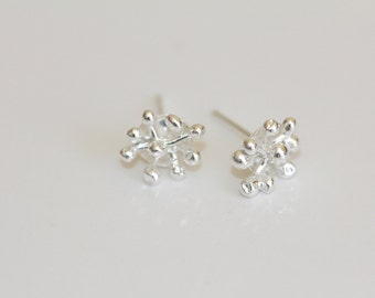Petite. Romantic. Sweet little earrings hand fabricated sterling silver studs.Made to order by Norita Designs