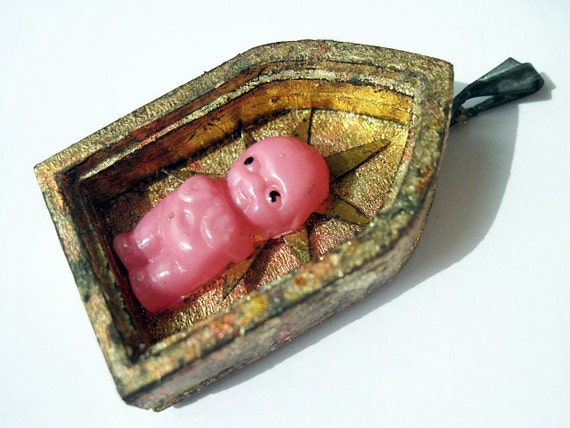 Every Child a Saviour. Pink Antique Celluloid Kewpie Doll Toy in Gold Leaf Shrine Pendant.