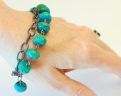 Turquoise and sterling wire wrapped artisan bracelet