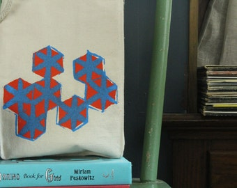 hexagon lunch bag recycled cotton orange with peacock blue water based ink