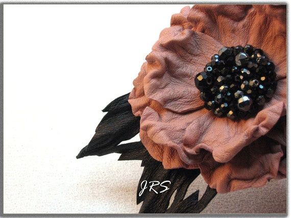 Pink leather flower brooch  .