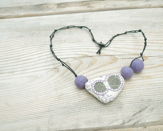 Felted necklace with beach stone and embroidery Lavender White