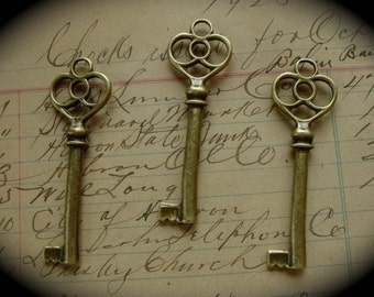 3 Victorian Gothic Skeleton Keys Stampings Charms