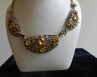 """1930's, 16 1/2"""" long, three part metal gold toned necklace, encrusted with beveled oval shaped amber glass stones"""