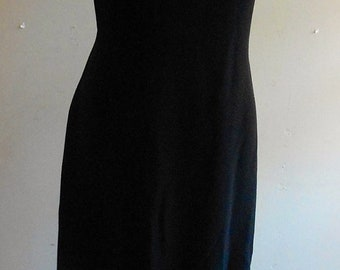 """1960's, 36"""" bust, black crepe full length grown, with a band of rhinestones at knee level."""
