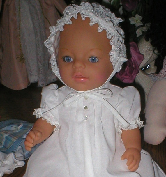 Baby doll in christening dress, plus 5 other outfits