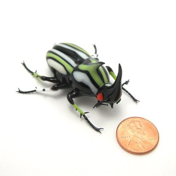 glass Racing Stripe Rhino Beetle - black, ivory, & green glass insect figurine
