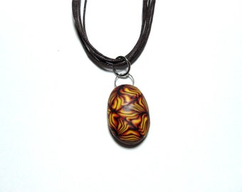 Handmade polymer clay pendant on a necklace