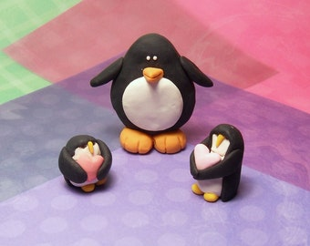 3 Handmade Polymer clay penguins set  2 holding hearts and one slim penguin
