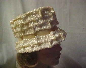 White woven straw cloche hat with velvet band around crown