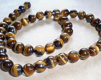Natural Tigers Eye 10mm Faceted Round Beads  Beautiful   8 inch Half Strands