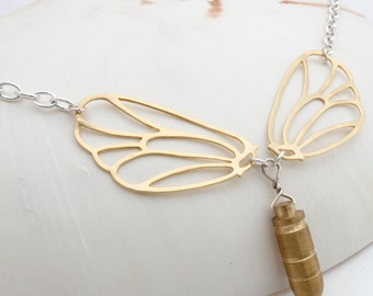 Bullet with butterfly wings- solid brass bullet necklace with gold plated butterfly wings and silver plated chain- War and Peace statement