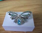 Vintage Silver Tone Avon Marcasite Finish Ribbon Brooch with Blue Rhinestone