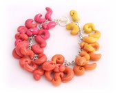 Polymer Clay Bracelet SALE 30% Off - Tropical Sunset Charm Bracelet - Hot Pink Sunny Yellow Orange - Curly Squiggle Charms - Bespoke Design