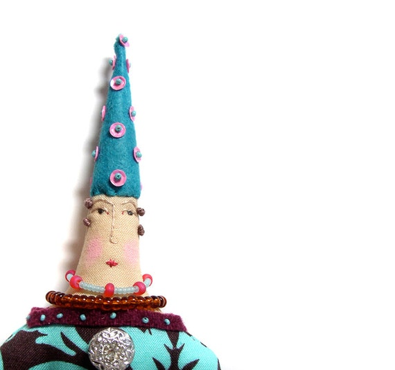 Whimsical textile cloth art doll with a fancy hat