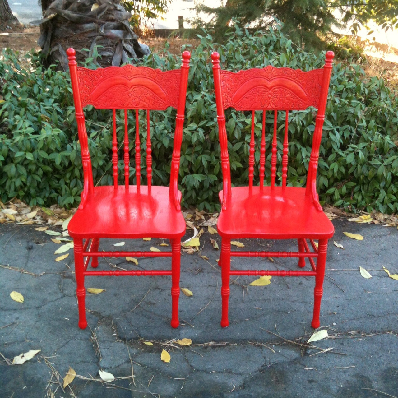 pair of vintage 1980s red wood farmhouse kitchen chairs