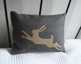 hand printed muted midnight blue  little leaping logo  hare cushion