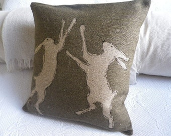 hand printed olive  rustic boxing hare cushion cover