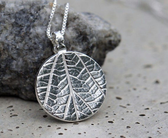 Leaf necklace. Silver coin necklace with leaf imprint, round disc pendant with sterling silver chain