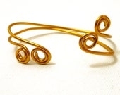 Simple Golden Swirl Bracelets- set of two wrap bangle cuffs