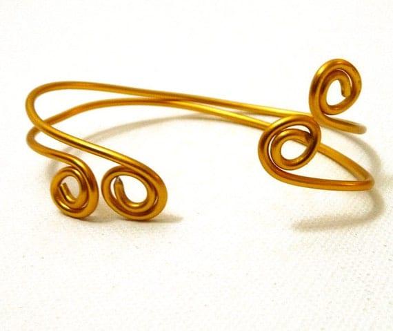 Simple Golden Swirl Bracelets- set of two wrap bangle cuffs