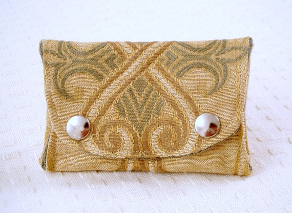 Fold over coin purse in recycled tapestry fabric.