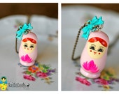 A light pink Babushka Necklace. Matryoshka necklace. a light pink wooden Russian doll. turquoise bow. girls gift. Folkloristic style.