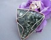 Seraphinite stone and silver and copper wire pendant