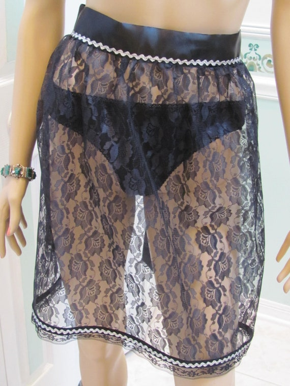 Black lace, half apron, hostess style, trimmed with silver rick rack and  black satin waist and ties
