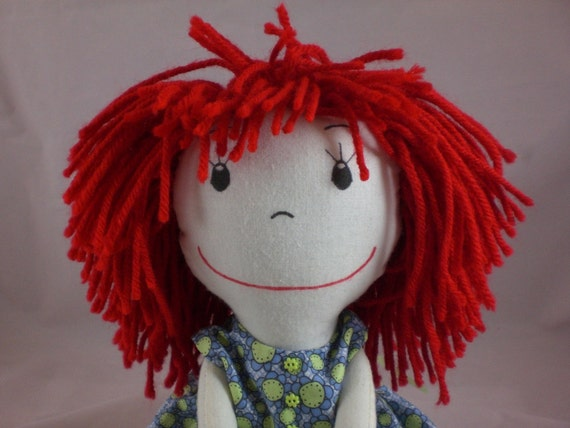Rag Doll, light skin tone and a mop of red hair - Blue flowered dress