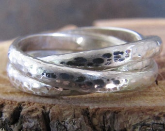 hammer textured and brush finished silver rolling ring
