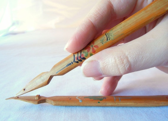https://www.etsy.com/listing/153953280/two-vintage-dip-calligraphy-pens-carved?ref=shop_home_active_11