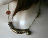 Brass vintage Tibetan bell and brass African bead necklace