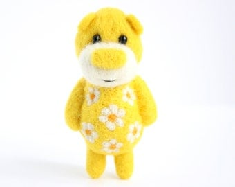 Yellow pocket bear with daisies