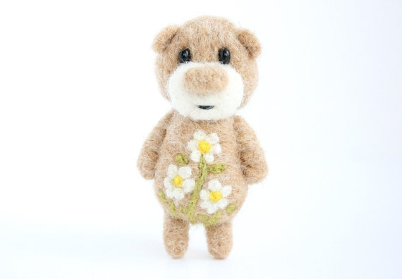 Light brown pocket bear with camomiles