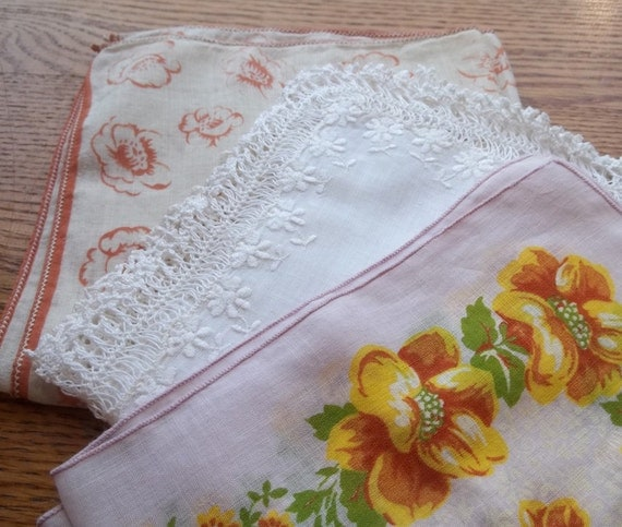 Three pretty vintage cotton hankies in white, pink, and soft orange floral patterns