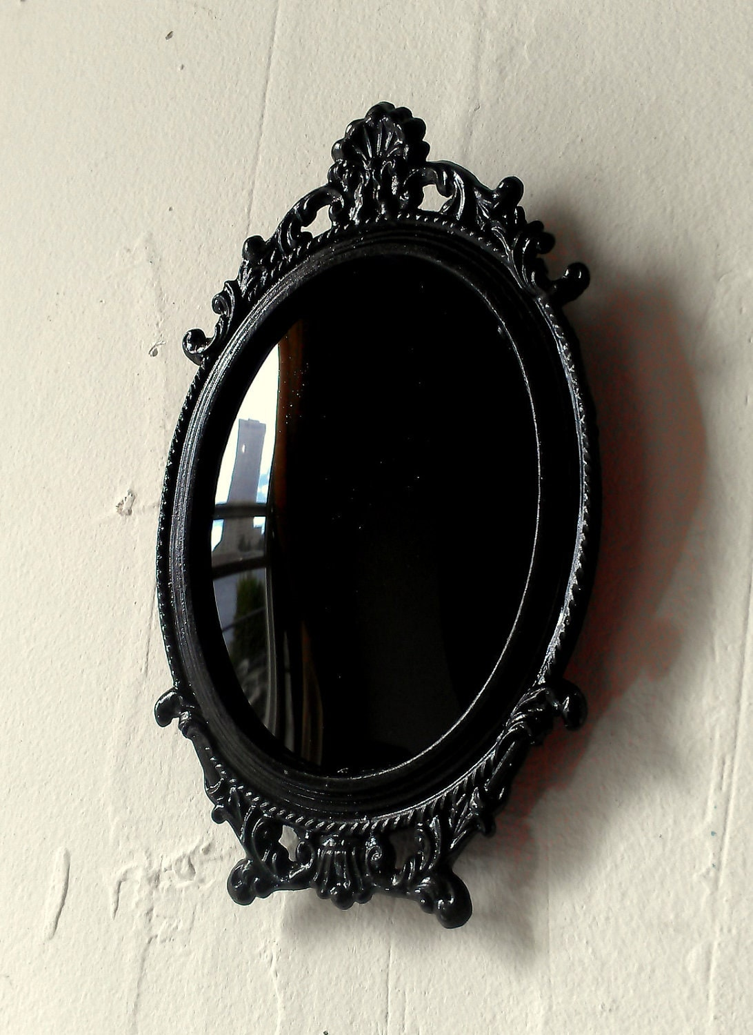 Black scrying mirror in miniature vintage oval frame with for Mirror black