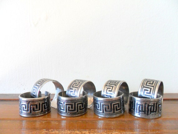 vintage silver plated india brass greek key banded napkin rings - set of eight - dinner party