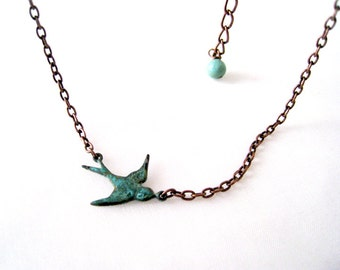 Flying Sparrow Necklace. antique copper necklace. flying bird necklace. simple style everyday necklace
