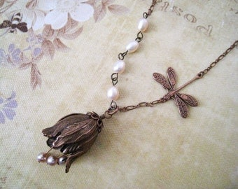 Tulip Necklace. antique copper tulip with flying dragonfly and freshwater pearls