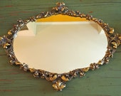 vintage rococo style mirror in gold
