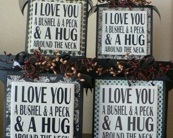 I Love You a Bushel and a Peck and a Hug around the Neck vinyl saying on wood block
