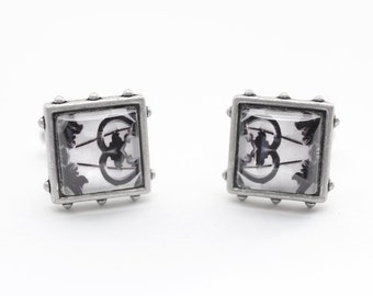 Old ironsides: eye catching cufflinks made with original photos mounted under glass
