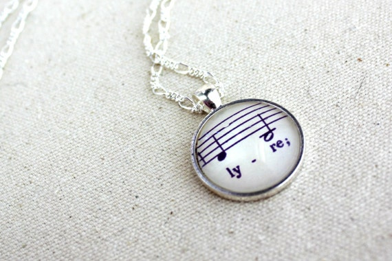 Sheet music necklace on figaro chain with purple text and music notes.  Lyre harp musical instrument jewelry for women
