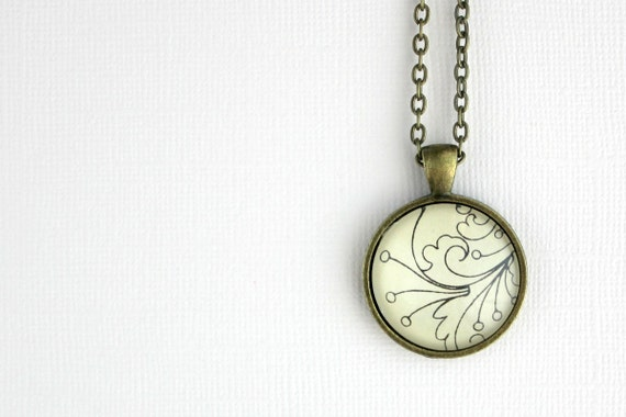 Modern floral black and white vintage style necklace made with sheet music design under glass on bronze chain