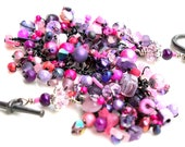 goth girl bracelet. pink and purple beaded jewelry.black wire wraps