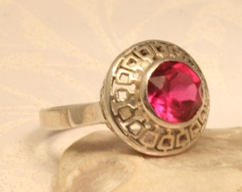 Pink crystal and silver ring. US size 6 3/4. UK size N.  Silver ring. Greek key ring